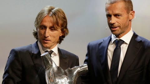 <p>               Luka Modric holds his UEFA Men's Player of the Year trophy as he stands next to UEFA President Aleksander Ceferin during the UEFA Champions League draw at the Grimaldi Forum, in Monaco, Thursday, Aug. 30, 2018. (AP Photo/Claude Paris)             </p>