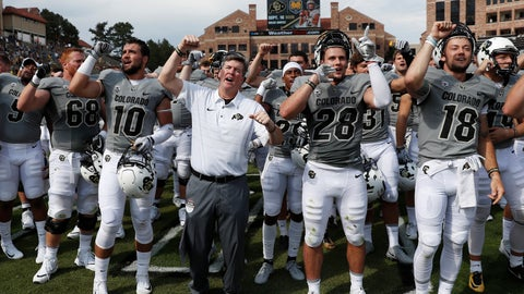 <p>               FILE - In this Saturday, Sept. 9, 2017, file photo, Colorado coach Mike MacIntyre, center, leads his players in the school fight song after a win over Texas State in an NCAA college football game in Boulder, Colo. Colorado is hoping to bounce back from a subpar season in 2017. (AP Photo/David Zalubowski, File)             </p>