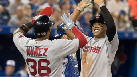 <p>               Boston Red Sox'sRafael Devers high-fives with Eduardo Nunez after Devers hit a two-run home run during the sixth inning of a baseball game against the Toronto Blue Jays on Wednesday, Aug. 8, 2018, in Toronto. (Fred Thornhill/The Canadian Press via AP)             </p>