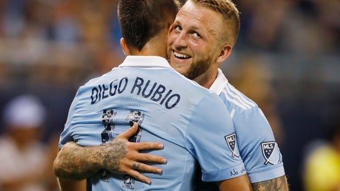 <p>               Sporting Kansas City forward Diego Rubio, left, celebrates with forward Johnny Russell, right, after scoring against Minnesota United during the second half of an MLS soccer match in Kansas City, Kan., Saturday, Aug. 25, 2018. Sporting KC won 2-0. (AP Photo/Colin E. Braley)             </p>