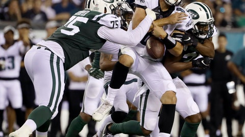 <p>               Philadelphia Eagles' Christian Hackenberg (8) fumbles the ball while being tackled by New York Jets' J.J. Wilcox (37) and Xavier Cooper (75) during the second half of a preseason NFL football game Thursday, Aug. 30, 2018, in Philadelphia. (AP Photo/Matt Rourke)             </p>