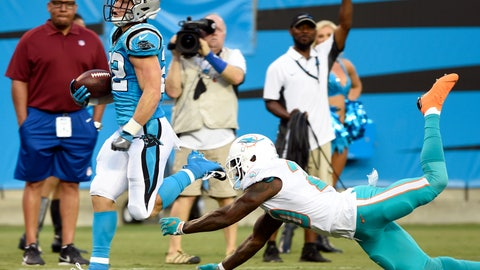 <p>               Carolina Panthers' Christian McCaffrey, left, runs past Miami Dolphins' T.J. McDonald, right, for a touchdown in the first half of a preseason NFL football game in Charlotte, N.C., Friday, Aug. 17, 2018. (AP Photo/Mike McCarn)             </p>