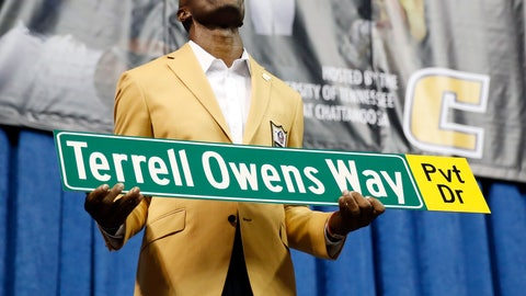 <p>               Former wide receiver Terrell Owens holds a street sign after a road was named for him following his Pro Football Hall of Fame speech, Saturday, Aug. 4, 2018, in Chattanooga, Tenn. Instead of speaking at the Hall of Fame events in Canton, Ohio, Owens celebrated his induction at the University of Tennessee at Chattanooga, where he played football and basketball and ran track. (AP Photo/Mark Humphrey)             </p>