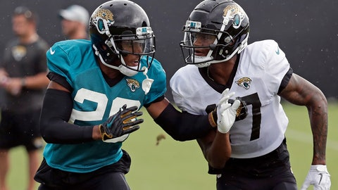 <p>               In this July 31, 2018, photo, Jacksonville Jaguars cornerback Jalen Ramsey (20) defends against receiver D.J. Chark Jr. during a practice at NFL football training camp in Jacksonville, Fla. Ramsey is making headlines from his couch. The Jaguars All-Pro cornerback is back in the news criticizing several NFL quarterbacks three days after being suspended for screaming obscenities at reporters. (AP Photo/John Raoux)             </p>