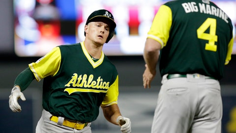 <p>               Oakland Athletics' Matt Chapman is congratulated by Athletics' third base coach Matt Williams (4) after hitting a three-run home run against the Minnesota Twins in the eighth inning during a baseball game Friday, Aug. 24, 2018, in Minneapolis. (AP Photo/Andy Clayton-King)             </p>
