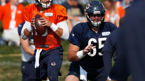 <p>               Chicago Bears quarterback Mitchell Trubisky, left, looks to pass the ball after taking a snap from center Cody Whitehair as they take part in drills during a joint NFL football training camp session with the Denver Broncos Thursday, Aug. 16, 2018, at Broncos' headquarters in Englewood, Colo. (AP Photo/David Zalubowski)             </p>