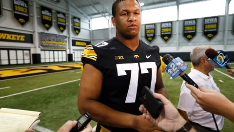 <p>               Iowa offensive lineman Alaric Jackson speaks to reporters during an NCAA college football media day, Friday, Aug. 10, 2018, in Iowa City, Iowa. (AP Photo/Charlie Neibergall)             </p>