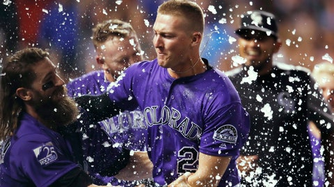 <p>               Colorado Rockies' Charlie Blackmon, left, congratulates Ryan McMahon for his three-run, walk-off home run off Los Angeles Dodgers relief pitcher JT Chargois during a baseball game Saturday, Aug. 11, 2018, in Denver. (AP Photo/David Zalubowski)             </p>