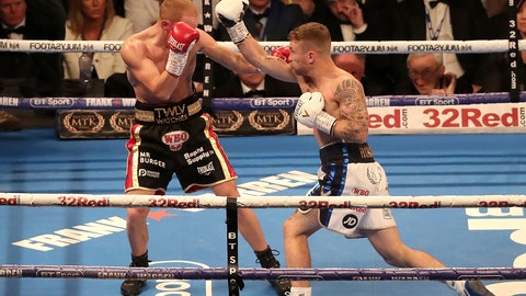 <p>               Carl Frampton, right, in action against Luke Jackson in their WBO Interim Featherweight title fight at Windsor Park in Belfast, Northern Ireland, Saturday Aug. 18, 2018. (Niall Carson/PA via AP)             </p>