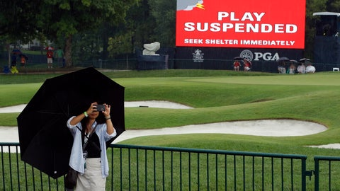 <p>               A patron takes a photo as play was suspended for the rest of the day during the second round of the PGA Championship golf tournament at Bellerive Country Club, Friday, Aug. 10, 2018, in St. Louis. Play was suspended due to heavy rain. (AP Photo/Charlie Riedel)             </p>