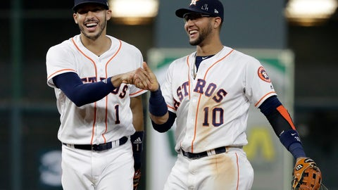 <p>               Houston Astros shortstop Carlos Correa (1) reacts with second baseman Yuli Gurriel (10) after fielding a ground ball by Colorado Rockies' Tony Wolters and throwing to first for the out during the ninth inning of a baseball game Wednesday, Aug. 15, 2018, in Houston. The Astros won 12-1. (AP Photo/David J. Phillip)             </p>