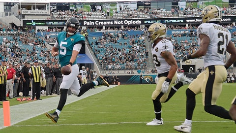 <p>               Jacksonville Jaguars quarterback Blake Bortles (5) runs past New Orleans Saints defensive backs Kurt Coleman, center, and Patrick Robinson (21) for a touchdown during the first half of an NFL preseason football game, Thursday, Aug. 9, 2018, in Jacksonville, Fla. (AP Photo/Phelan M. Ebenhack)             </p>