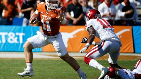 <p>               FILE - In this Oct. 14, 2017, file photo, Texas quarterback Sam Ehlinger (11) tries to get past Oklahoma linebacker Kenneth Murray (9) and cornerback Parnell Motley (11) during the first half of an NCAA college football game in Dallas. Ehlinger won the starter's job over junior Shane Buechele. Texas faces Maryland on Saturday. (AP Photo/Ron Jenkins, File)             </p>