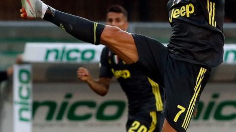 <p>               Juventus' Cristiano Ronaldo reaches for the ball during the Serie A soccer match between Chievo Verona and Juventus, at the Bentegodi Stadium in Verona, Italy, Saturday, Aug. 18, 2018. (AP Photo/Antonio Calanni)             </p>
