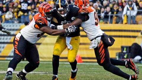 <p>               FILE - This Dec. 23, 2012 file photo shows Pittsburgh Steelers quarterback Ben Roethlisberger (7) being tackled after a 4-yard scramble, by Cincinnati Bengals defensive tackle Geno Atkins, left, and defensive end Carlos Dunlap during the fourth quarter of an NFL football game in Pittsburgh. The Bengals have agreed to contract extensions with defensive tackle Geno Atkins and end Carlos Dunlap, who were entering the final years on their deals, Tuesday, Aug. 28, 2018. (AP Photo/Gene J. Puskar, File)             </p>
