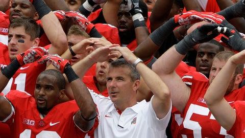 <p>               FILE - In this Sept. 1, 2012, file photo, Ohio State NCAA college football head coach Urban Meyer leads the team in singing Carmen Ohio after beating Miami of Ohio 56-10, in Columbus, Ohio.  Ohio State suspended coach Urban Meyer for three games on Wednesday night, Aug. 22, 2018, for mishandling repeated professional and behavioral problems of an assistant coach, with investigators finding Meyer protected his protege for years through domestic violence allegations, a drug problem and poor job performance. The superstar coach's treatment of his now-fired assistant was also clouded by his abiding devotion to the legacy of former Ohio State coach Earle Bruce, the grandfather of former wide receivers coach Zach Smith and an early coaching mentor for Meyer. (AP Photo/Jay LaPrete, File)             </p>