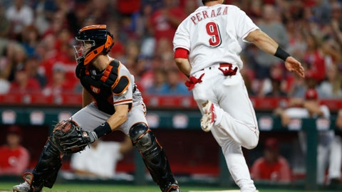 <p>               Cincinnati Reds' Jose Peraza (9) scores as San Francisco Giants catcher Buster Posey, left, looks for the throw during the fifth inning of a baseball game Saturday, Aug. 18, 2018, in Cincinnati. (AP Photo/Gary Landers)             </p>