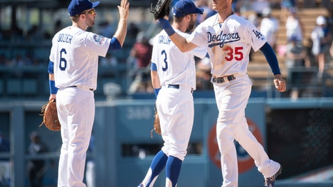 <p>               Los Angeles Dodgers second baseman Brian Dozier, left, and center fielder Cody Bellinger celebrate their win over the Houston Astros in a baseball game in Los Angeles, Sunday, Aug. 5, 2018. (AP Photo/Kyusung Gong)             </p>