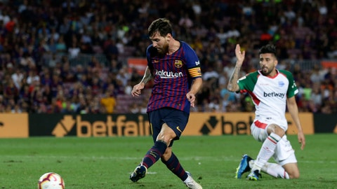 <p>               FC Barcelona's Lionel Messi kicks the ball to score against Alaves during a Spanish La Liga soccer match at Camp Nou stadium in Barcelona, Spain, Saturday, Aug. 18, 2018. (AP Photo/Manu Fernandez)             </p>