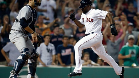 <p>               Boston Red Sox's Jackie Bradley Jr., right, scores in front of New York Yankees' Austin Romine after a throwing error by Miguel Andujar during the ninth inning of a baseball game in Boston, Monday, Aug. 6, 2018. (AP Photo/Michael Dwyer)             </p>