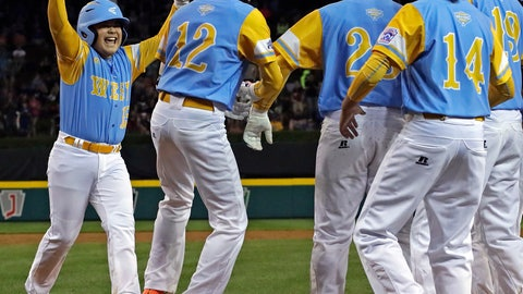 <p>               Honolulu's Sean Yamaguchi, left, is greeted by teammates after hitting a grand slam off Staten Island (N.Y.)'s Chris Bedford during the second inning of a baseball game at the Little League World Series in South Williamsport, Pa., Wednesday, Aug. 22, 2018. Hawaii won 10-0 in five innings. (AP Photo/Gene J. Puskar)             </p>
