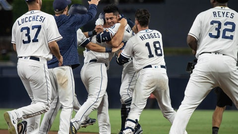 <p>               San Diego Padres celebrate after Christian Villanueva, center right, hit a walk-off single against the Arizona Diamondbacks during a baseball game in San Diego, Saturday, Aug. 18, 2018. The Padres won 7-6. (AP Photo/Kyusung Gong)             </p>