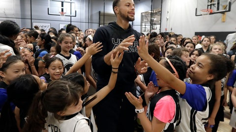 """<p>               Golden State Warriors' Stephen Curry, center, greets basketball camp participants after taking a group photo at Ultimate Fieldhouse in Walnut Creek, Calif., Tuesday, Aug. 14, 2018. For the first time, Curry hosted only girls for a free, Warriors-run camp Monday and Tuesday at Walnut Creek's Ultimate Fieldhouse. Last week at the same facility that he has also chosen in recent years, the Golden State star held his Under Armour """"Stephen Curry Select Camp"""" with two of the nation's top high school girls playing mixed right in with the best boys. The two-time MVP and father of two young daughters has made it his mission to better support the girls' game. He asked longtime Warriors camp director Jeff Addiego to plan an all-girls session this summer. (AP Photo/Jeff Chiu)             </p>"""