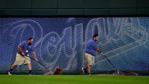 <p>               Grounds crew workers roll water off the warning track during a delay during the fourth inning of a baseball game between the Kansas City Royals and the Cleveland Indians on Friday, Aug. 24, 2018, in Kansas City, Mo. The water was believed to come from a leak in a fountain in right field delaying the game for half an hour. (AP Photo/Charlie Riedel)             </p>