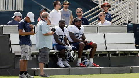 <p>               Tennessee Titans running backs Dion Lewis (33) and Derrick Henry (22) rest on a cooling bench during NFL football training camp Wednesday, Aug. 15, 2018, in Nashville, Tenn. The Titans put a bench on each side of their three practice fields, giving players a chance to recover when the temperature during morning practices can feel like 90 degrees. (AP Photo/Mark Humphrey)             </p>