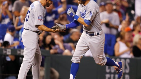 <p>               Los Angeles Dodgers third base coach Chris Woodward, left, congratulates Chris Taylor, who heads for home on a solo home run off Colorado Rockies relief pitcher Wade Davis during the ninth inning of a baseball game Thursday, Aug. 9, 2018, in Denver. (AP Photo/David Zalubowski)             </p>