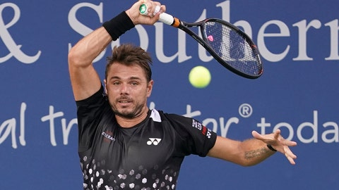 <p>               Stan Wawrinka, of Switzerland, returns to Diego Schwartzman, of Argentina, in the first round at the Western & Southern Open, Monday, Aug. 13, 2018, in Mason, Ohio. (AP Photo/John Minchillo)             </p>