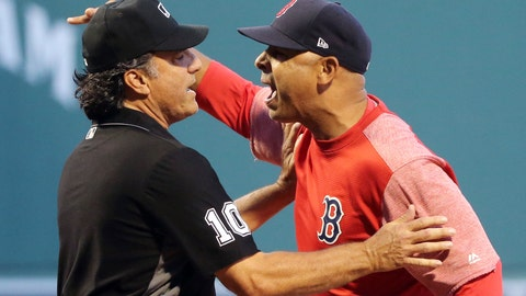 <p>               Boston Red Sox manager Alex Cora is held back by first base umpire Phil Cuzzi (10) as Cora argues with home plate umpire Adam Hamari after both Red Sox and New York Yankees pitchers were warned against hitting batters, during the first inning of a baseball game at Fenway Park, Friday, Aug. 3, 2018, in Boston. Cora was ejected. (AP Photo/Elise Amendola)             </p>