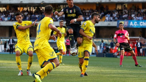 <p>               Juventus' Cristiano Ronaldo jumps as he reaches for the ball during the Serie A soccer match between Chievo Verona and Juventus, at the Bentegodi Stadium in Verona, Italy, Saturday, Aug. 18, 2018. (AP Photo/Antonio Calanni)             </p>