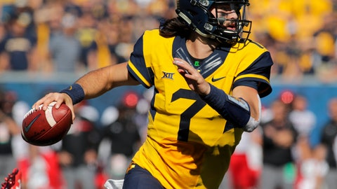 <p>               FILE - In this Oct. 14, 2017, file photo, West Virginia quarterback Will Grier (7) rolls out during an NCAA college football game, in Morgantown, W.Va. Grier and wide receiver David Sills announced four days apart last December that they would return for their senior seasons. They'll lead No. 17 West Virginia into Saturday's season opener against Tennessee in Charlotte, N.C. (AP Photo/Raymond Thompson, File)             </p>