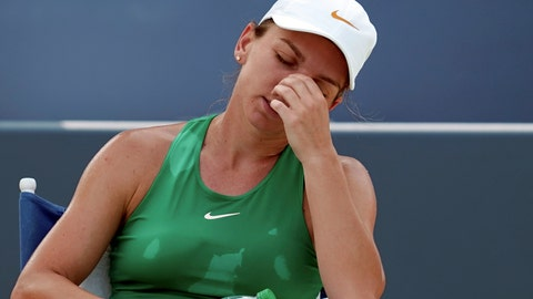 <p>               Simona Halep, of Romania, reacts during a side change in a finals match against Kiki Bertens, of the Netherlands, at the Western & Southern Open tennis tournament, Sunday, Aug. 19, 2018, in Mason, Ohio. (AP Photo/John Minchillo)             </p>