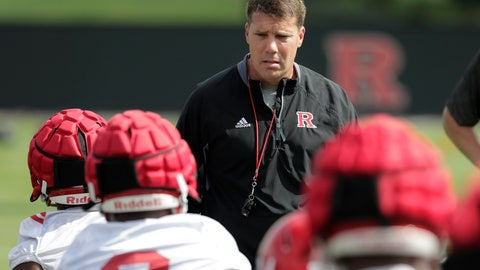 <p>               In a photo taken Friday, Aug. 3, 2018, Rutgers head coach Chris Ash, center, talks to running backs as they stretch during NCAA college football training camp in Piscataway, N.J. (AP Photo/Julio Cortez)             </p>