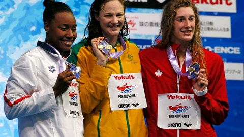 <p>               Australia's Cate Campbell, center, poses with her medal on the podium after winning the women's 100m freestyle final with second-placed Simone Manuel, left of the U.S., and third-placed Ruck Taylor of Canada during the Pan Pacific swimming championships in Tokyo,Friday, Aug. 10, 2018. (AP Photo/Koji Sasahara)             </p>
