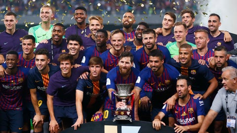 <p>               Barcelona players pose with the trophy after winning the Spanish Super Cup soccer match between Sevilla and Barcelona in Tangier, Morocco, Sunday, Aug. 12, 2018. Barcelona won 2-1. (AP Photo/Mosa'ab Elshamy)             </p>