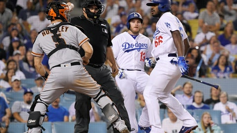 <p>               San Francisco Giants catcher Nick Hundley, left, reacts to being shoved by Los Angeles Dodgers' Yasiel Puig, right, as they argue while home plate umpire Eric Cooper, second from left, gets between them and Max Muncy runs in during the seventh inning of a baseball game, Tuesday, Aug. 14, 2018, in Los Angeles. (AP Photo/Mark J. Terrill)             </p>