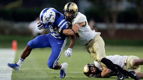 <p>               Duke's Brittain Brown (22) is forced out of bounds by Army's Max Regan during the first half of an NCAA college football game in Durham, N.C., Friday, Aug. 31, 2018. (AP Photo/Gerry Broome)             </p>