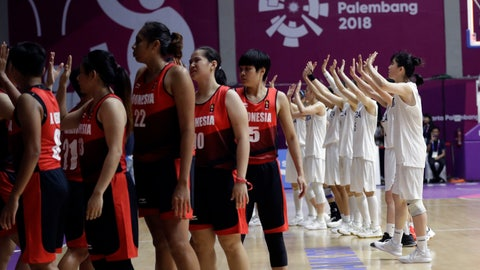 <p>               Combined Koreas players, right, wave to their supporters after defeating Indonesia in their women's basketball match at the 18th Asian Games in Jakarta, Indonesia, Wednesday, Aug. 15, 2018. (AP Photo/Tatan Syuflana)             </p>