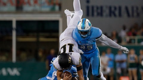 <p>               Tulane's Roderic Teamer Jr., left, and Will Harper, right, tackle Wake Forest quarterback, Sam Hartman (10) during the first half of an NCAA college football game in New Orleans on Thursday, Aug. 30, 2018. (AP Photo/Veronica Dominach)             </p>