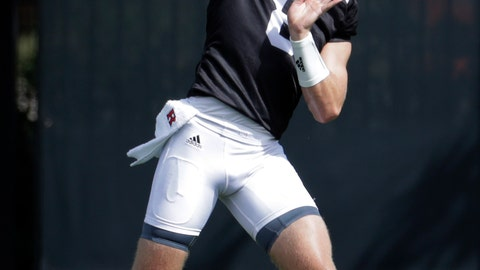 <p>               In a photo taken Friday, Aug. 3, 2018, Rutgers quarterback Artur Sitkowski works out during NCAA college football training camp in Piscataway, N.J. (AP Photo/Julio Cortez)             </p>
