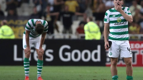 <p>               Celtic's James Forrest, right, reacts at the end of a Champions League third qualifying round, second leg, soccer match between AEK Athens and Celtic at the Olympic stadium in Athens, Tuesday, Aug. 14, 2018. (AP Photo/Petros Giannakouris)             </p>