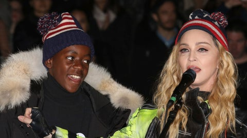 <p>               FILE- In this Nov 7, 2016 file photo, U.S. Singer Madonna, right, and her son David Banda perform in support of Democratic presidential candidate Hillary Clinton at Washington Square Park. The Queen of Pop is also a soccer mom and she's getting ever more involved in the beautiful game. Madonna has plans to open a soccer academy in Malawi, inspired by her adopted son David Banda who has ambitions to be a professional player and is at Portuguese club Benfica's youth academy. (Photo by Greg Allen/Invision/AP file)             </p>