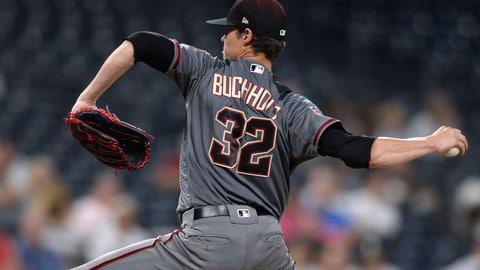 <p>               Arizona Diamondbacks starting pitcher Clay Buchholz works against a San Diego Padres batter during the ninth inning of a baseball game Thursday, Aug. 16, 2018, in San Diego. Buchholz threw a five-hitter as the Diamondbacks won 5-1. (AP Photo/Orlando Ramirez)             </p>