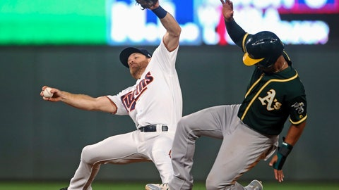 <p>               Oakland Athletics' Marcus Semien, right, advances to second on a hit by Ramon Laureano as Minnesota Twins second baseman Logan Forsythe tries to maintain his balance in the fourth inning of a baseball game Thursday, Aug. 23, 2018, in Minneapolis. (AP Photo/Jim Mone)             </p>