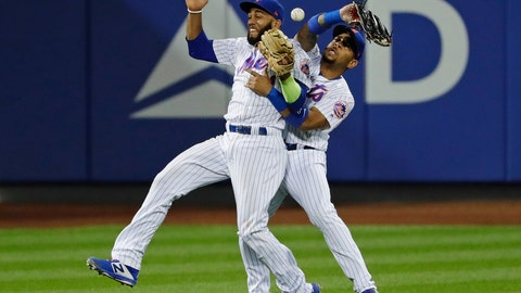 <p>               New York Mets' Amed Rosario (1) and Dominic Smith (22) collide while trying to catch a ball hit by San Francisco Giants' Brandon Crawford during the thirteenth inning of a baseball game Monday, Aug. 20, 2018, in New York. Andrew McCutchen scored on the error by Smith. (AP Photo/Frank Franklin II)             </p>