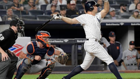<p>               New York Yankees' Brett Gardner, right, hits a two-run home run as Detroit Tigers catcher James McCann, center, and umpire Nic Lentz, left, look on during the sixth inning of a baseball game Friday, Aug. 31, 2018, at Yankee Stadium in New York. (AP Photo/Bill Kostroun)             </p>