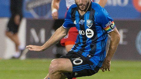 <p>               Montreal Impact's Ignacio Piatti scrambles for the ball against the Chicago Fire during the second half of an MLS soccer match in Montreal on Saturday, Aug. 18, 2018. (Peter Mccabe/The Canadian Press via AP)             </p>